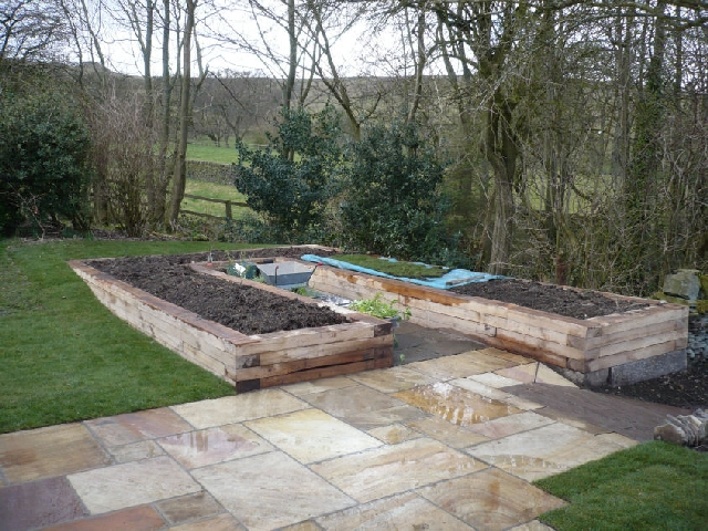 Raised Oak Planters Replace the Existing Vegatable Garden.