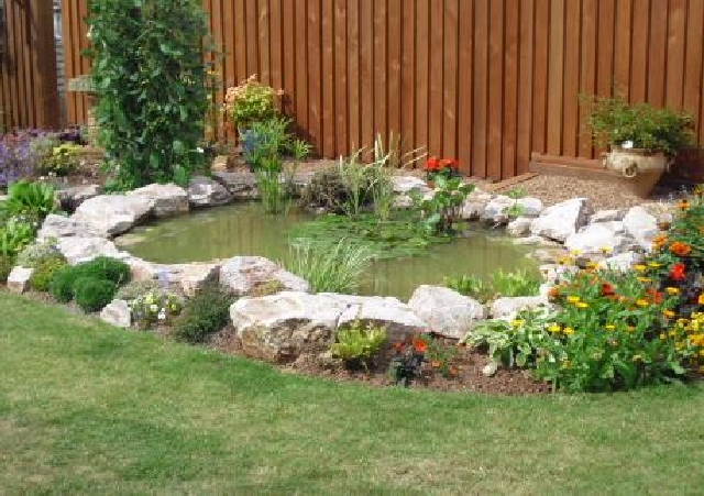 Pond After Landscaping Using Stoneycombe Limestone.