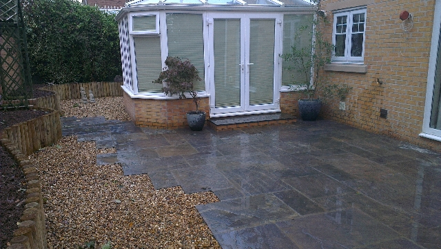 Indian Sandstone Paving. (Borderstone Twilight) with Log Planter