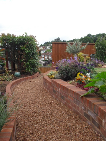 brick retaining wall and raised flower beds